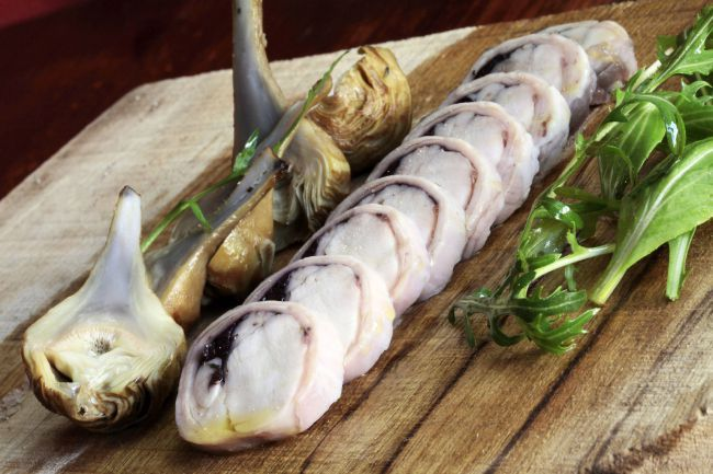 Saddle of Rabbit Stuffed with Olives and Baby Purple Artichokes Flavored with Thyme by chef Ludovic Aillaud